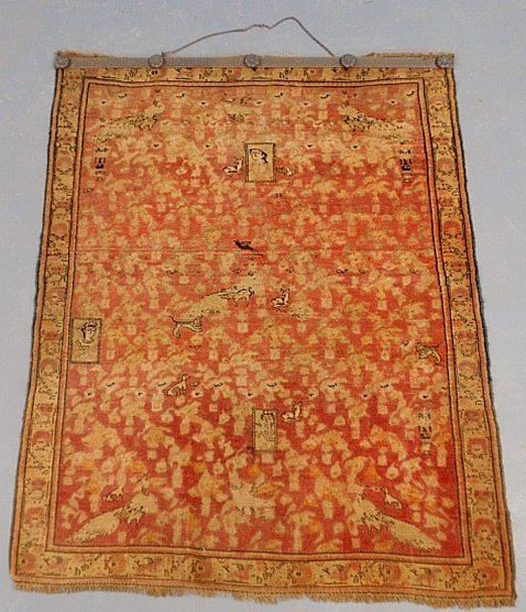 Early Persian oriental mat with a red field and animal