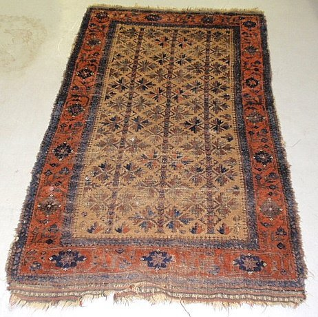 Balouch oriental mat with a tan field and red border. 6