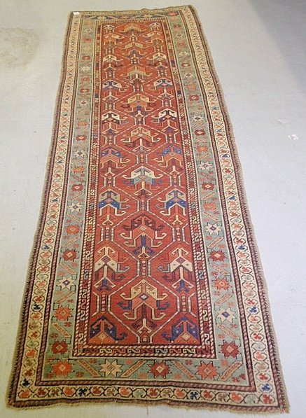 Caucasian oriental hall runner with a red field, overal
