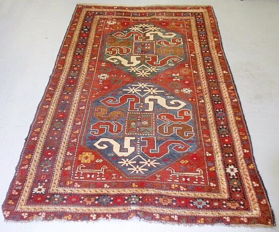 Caucasian oriental hall mat with a red field and geomet