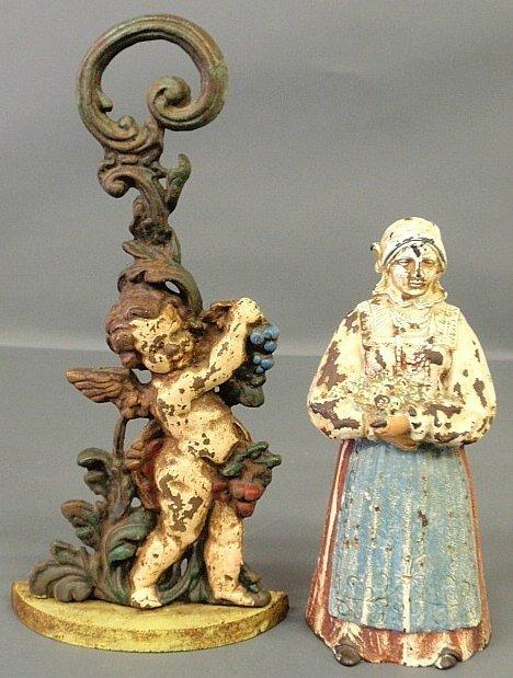 Two Victorian cast iron doorstops, cherub with grapes 1