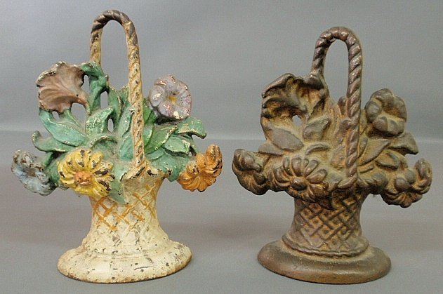 Two Victorian doorstops, brass basket of flowers and a