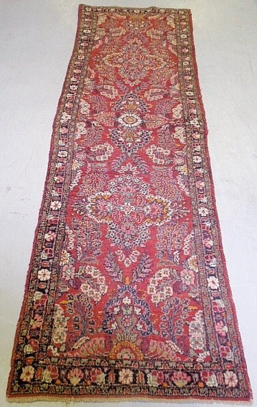 Sarouk oriental hall runner with floral patterns and
