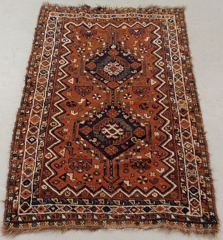 Oriental mat with rust field and two geometric