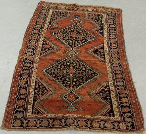 Kazak oriental carpet with two geometric medallions and