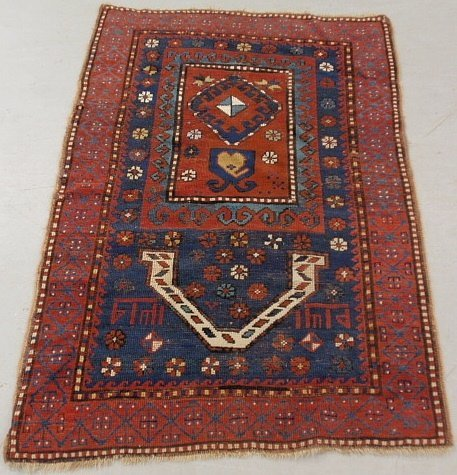 Oriental prayer mat with floral rosettes and red field