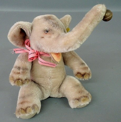 Steiff elephant, c.1952, with button and stock tag.