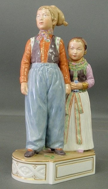 Early colorful royal Copenhagen figural group of a boy