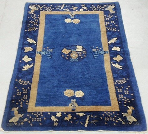 Blue Chinese oriental mat with bird and potted flower