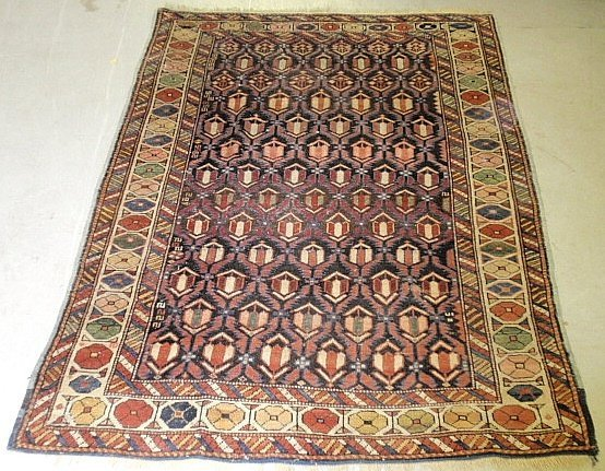 Caucasian oriental mat with colorful geometric