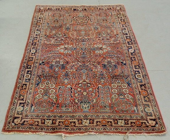 Sarouk oriental center hall carpet with red field and