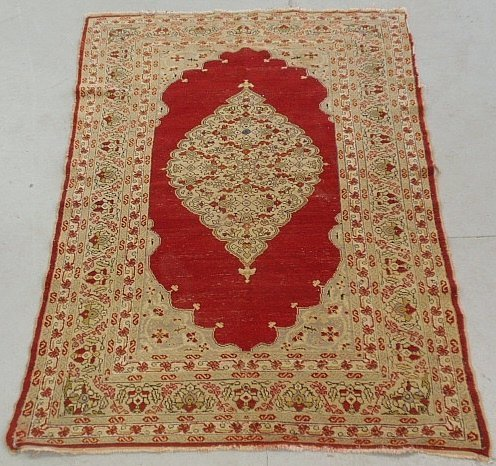 Persian oriental mat with red field and floral