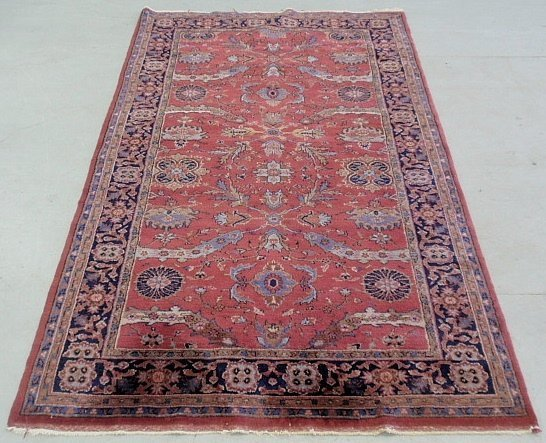 Large Sarouk oriental center hall carpet with red field