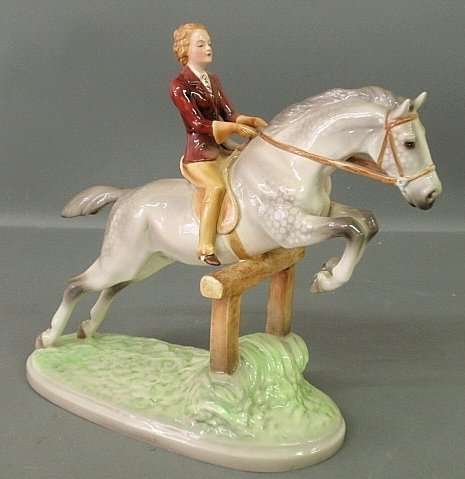 Large porcelain equine statue of a woman on a dapple