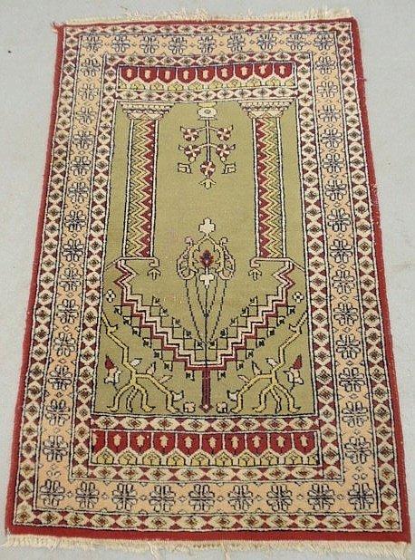 Persian oriental prayer rug with light green field.