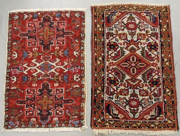 Two Persian mats with red fields and floral patterns.
