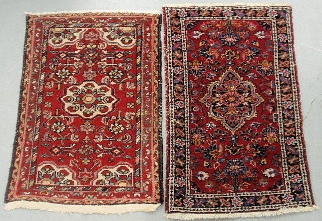 Two similar Persian oriental mats with red fields and
