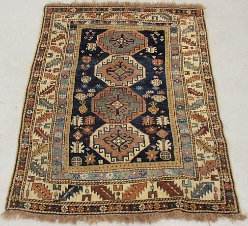 Shirvan oriental hall carpet with a dark blue field and