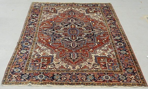 Room size Heriz oriental carpet with a red field, blue