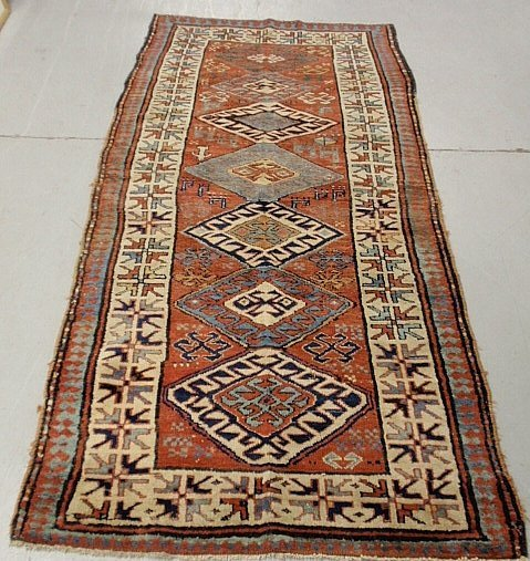 Colorful Kazak oriental hall runner with seven center m