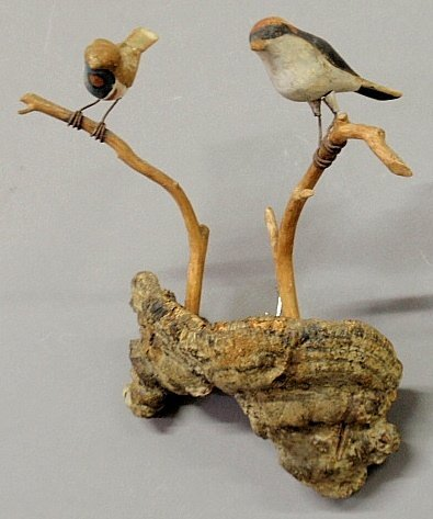 Two folk art carved and paint decorated birds, c.1930,