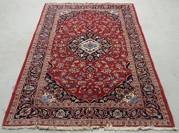 Kashan center hall oriental carpet with a red field,