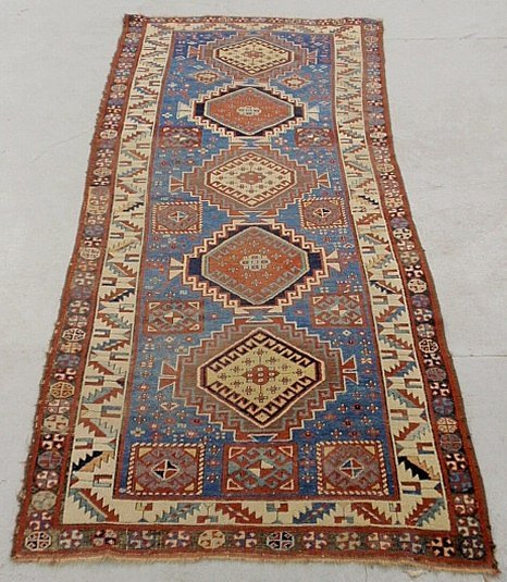 Colorful Kazak oriental hall runner with a blue field