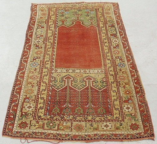 Colorful Turkish oriental prayer carpet with a red