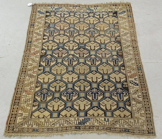 Dagestan oriental mat with overall geometric patterns.