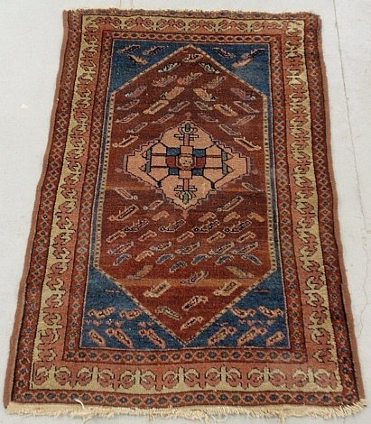 Hamadan oriental mat with a red field and blue corners.