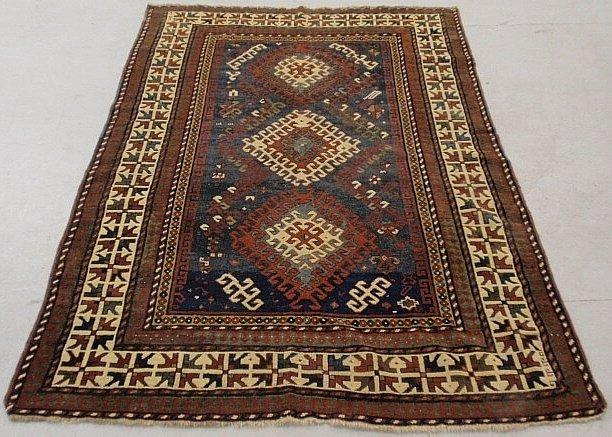 Colorful Kazak oriental carpet with a blue center