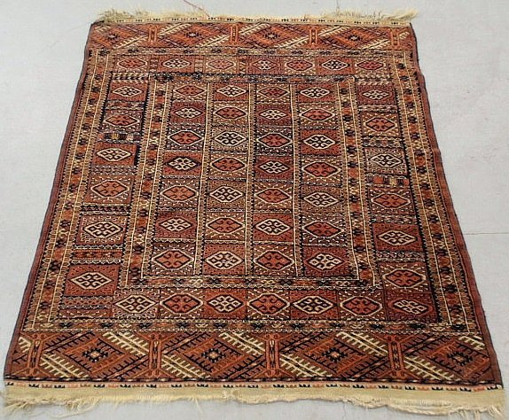 Yomud oriental mat with overall geometric patterns.