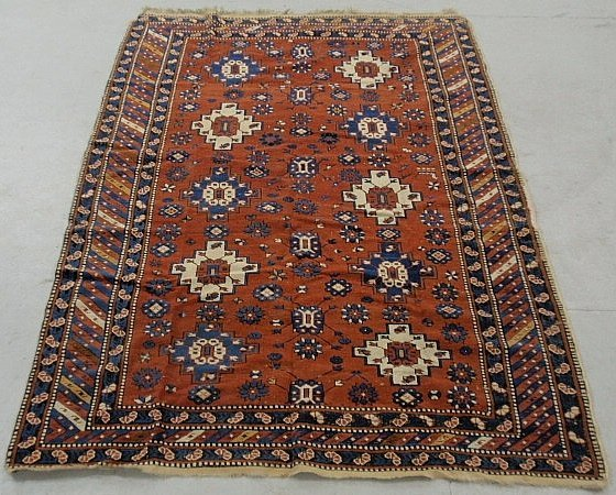 Shirvan center hall carpet, c.1900, with a red field an