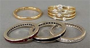 Five ladies rings: 3channel set 14k wg bands-1 diamonds
