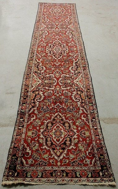 Hamadan oriental hall runner with a red field and
