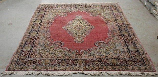 Kerman oriental carpet with a dark pink field, center