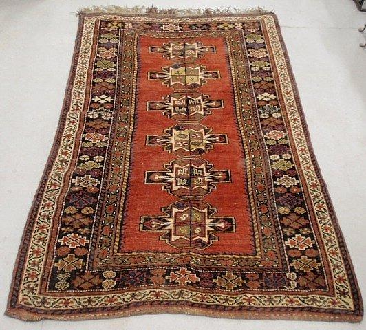 Kazak style oriental center hall carpet with red field