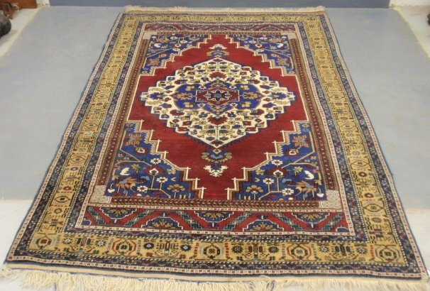 Colorful Heriz type oriental carpet with red field and