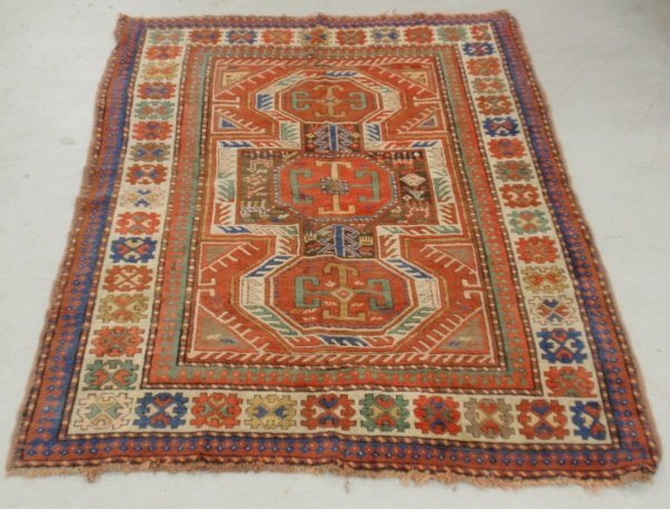 Kazak oriental center hall carpet with red field and
