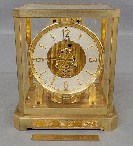 "Swiss LeCoultre 15 jewel Atmos clock. 9.25""h.x8.5""w."