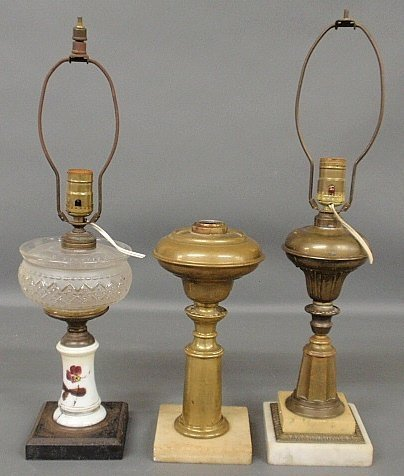 Two brass oil lamps with alabaster bases, tallest to
