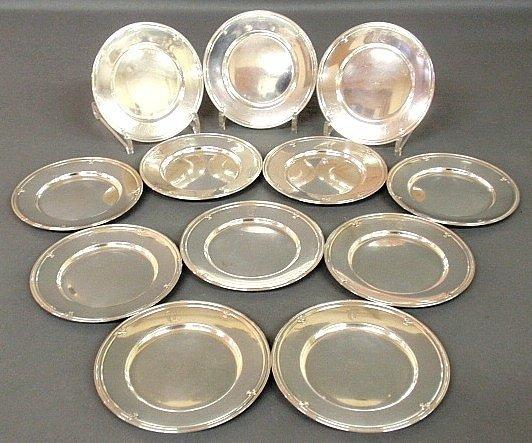 Set of twelve sterling silver bread & butter plates.
