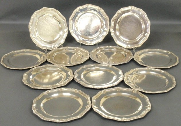 Fine set of twelve Georgian silver plates with engraved