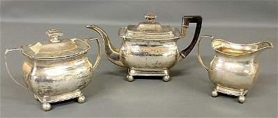Threepiece coin silver tea service by W Thomson