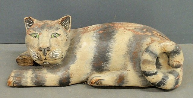 Large folk art paint decorated reclining cat. As found.
