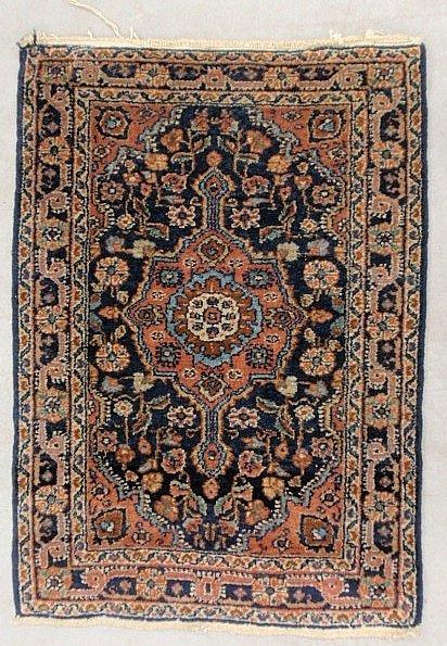 Sarouk oriental mat with center medallion and blue fiel