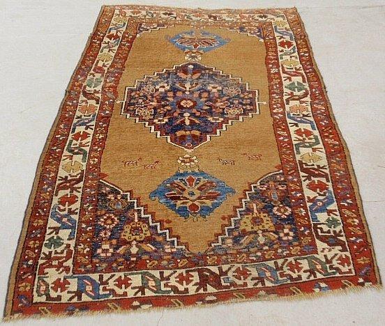 Kazak oriental carpet with brown field and geometric pa
