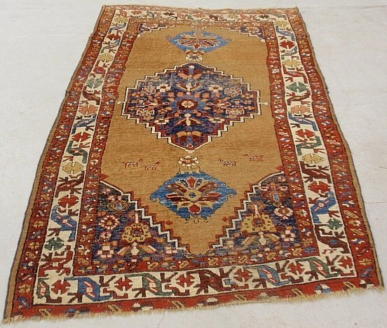 Kazak oriental carpet with brown field and geometric