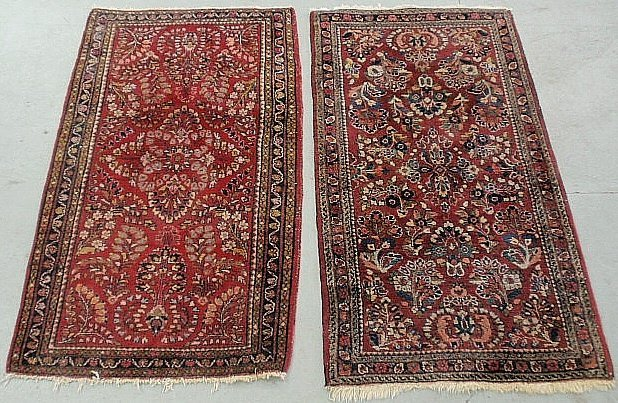 Two Sarouk oriental mats with red fields. Each approx