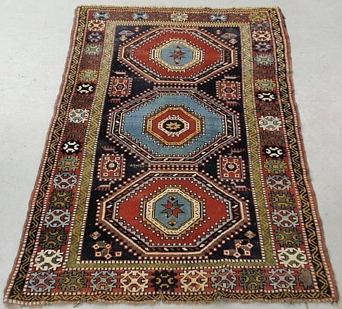 Colorful Caucasian oriental mat with three center